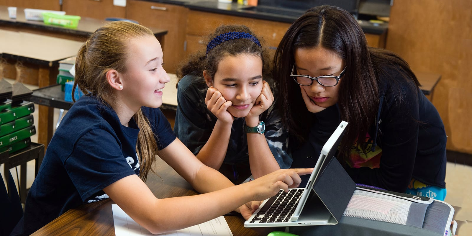 Photo of middle school aged girls sharing a laptop