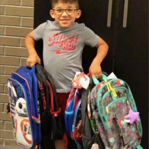 William donates backpacks