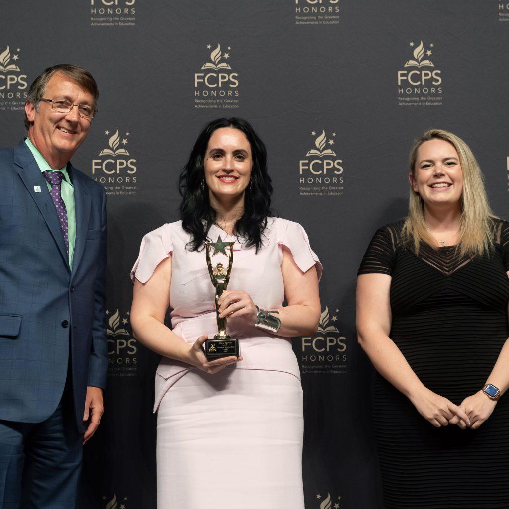 Maria Perrone. one of the Outstanding Nonschool-Based Leaders is honored by Dr. Brabrand and Bridget Werkheiser, Milestone Towers