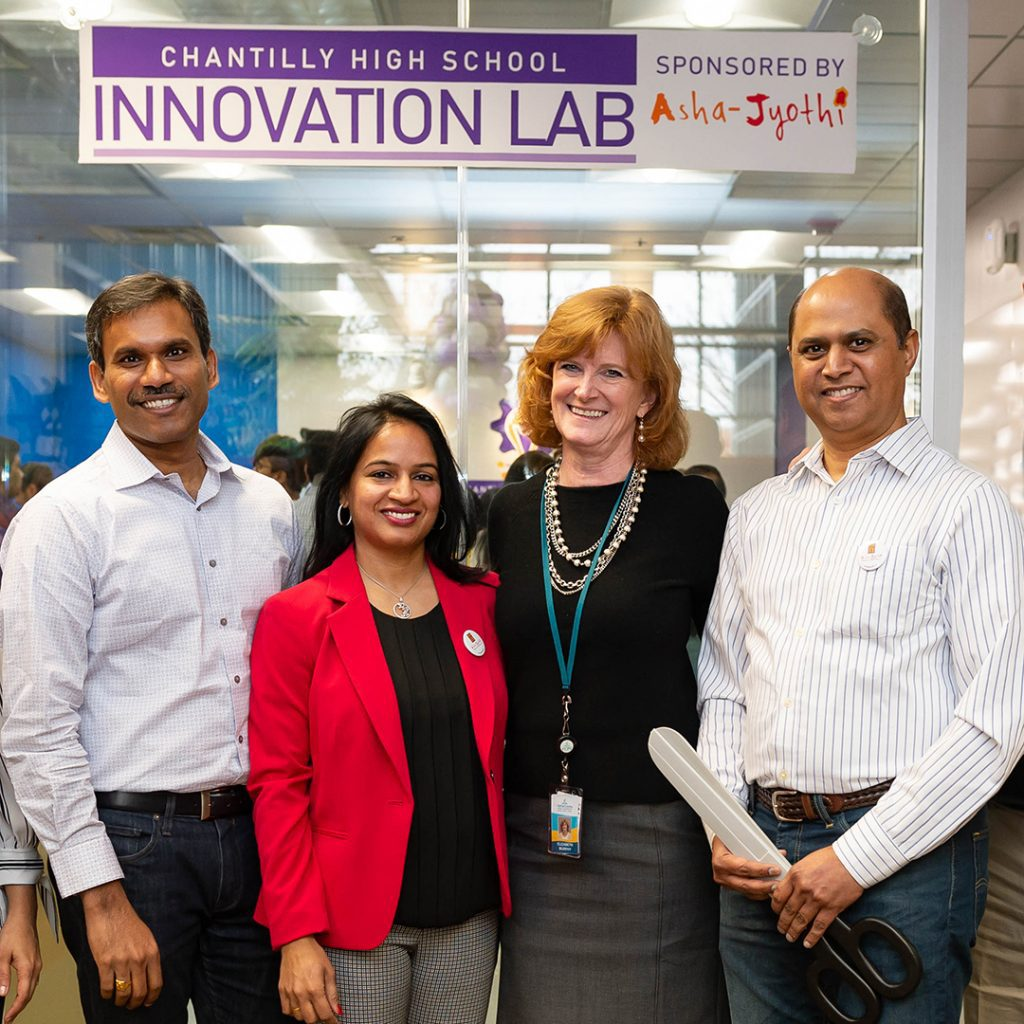 Executive Director Elizabeth Murphy and members of Asha Jyothi attend the launch of the Innovation Lab at Chantilly High School