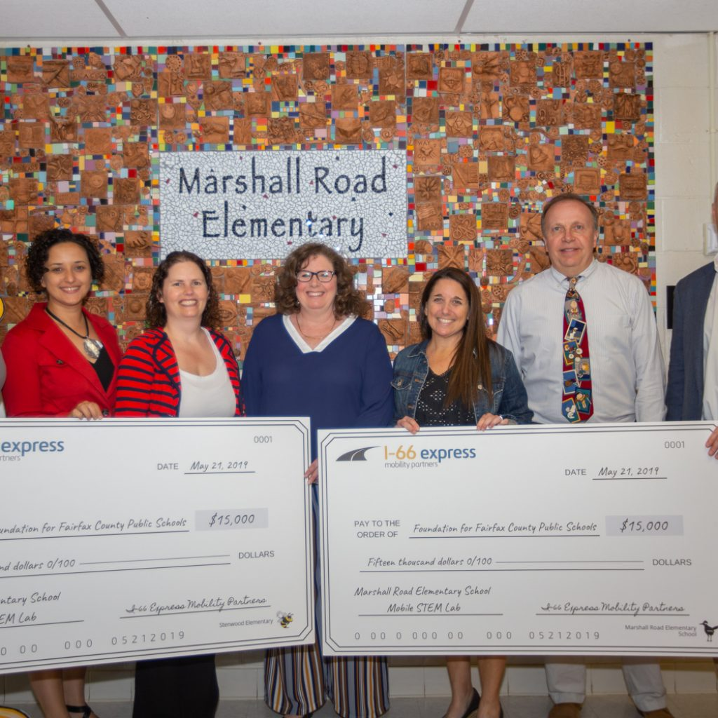Elizabeth Murphy and staff from Marshall Road Elementary and Stenwood Elementary receive funds from I66 Mobility to fund STEAM efforts
