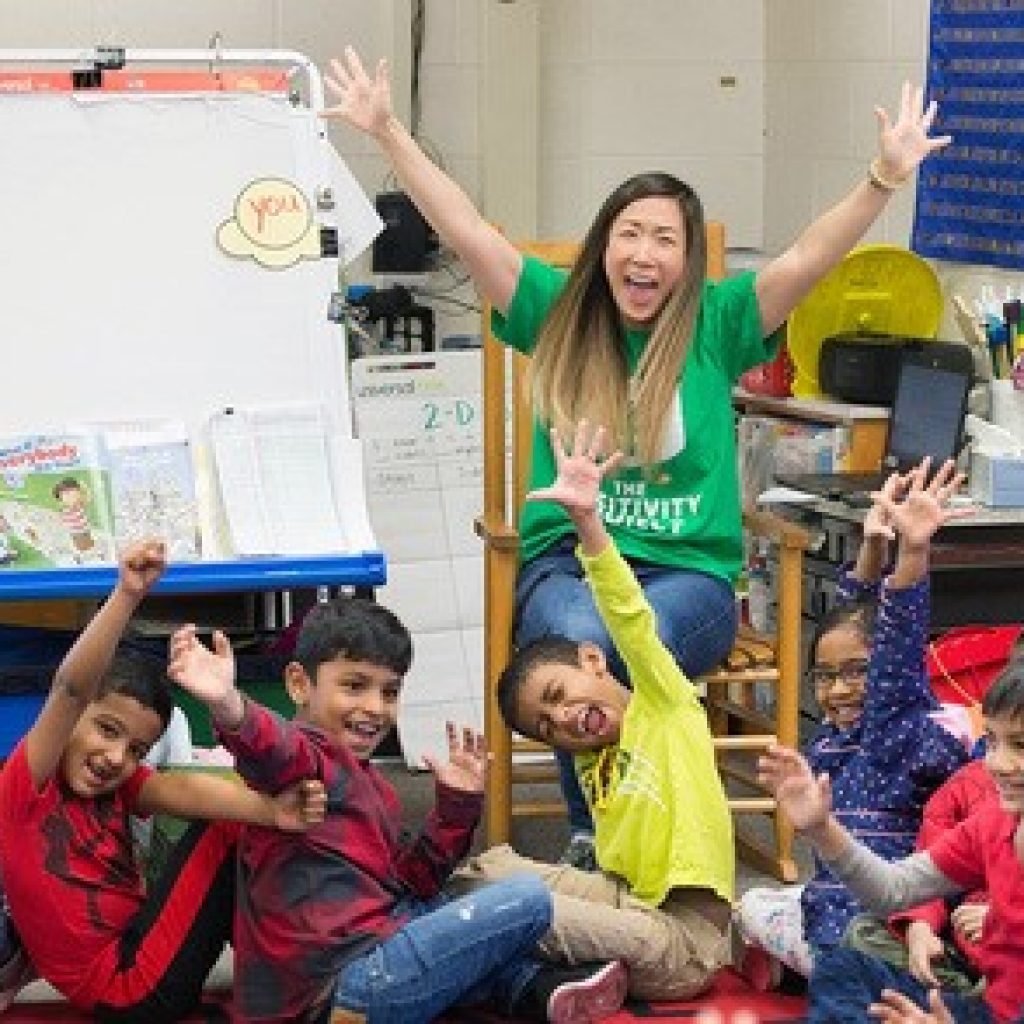 excited teacher with students