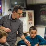 Photo of male teacher with students
