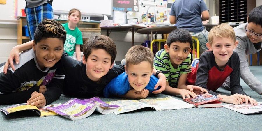 Photo of boys reading on floor