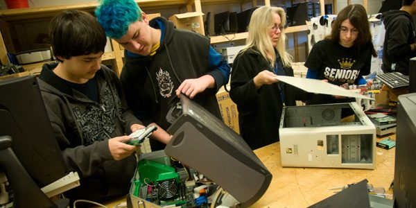Photo of high school students rebuilding computer hard drives